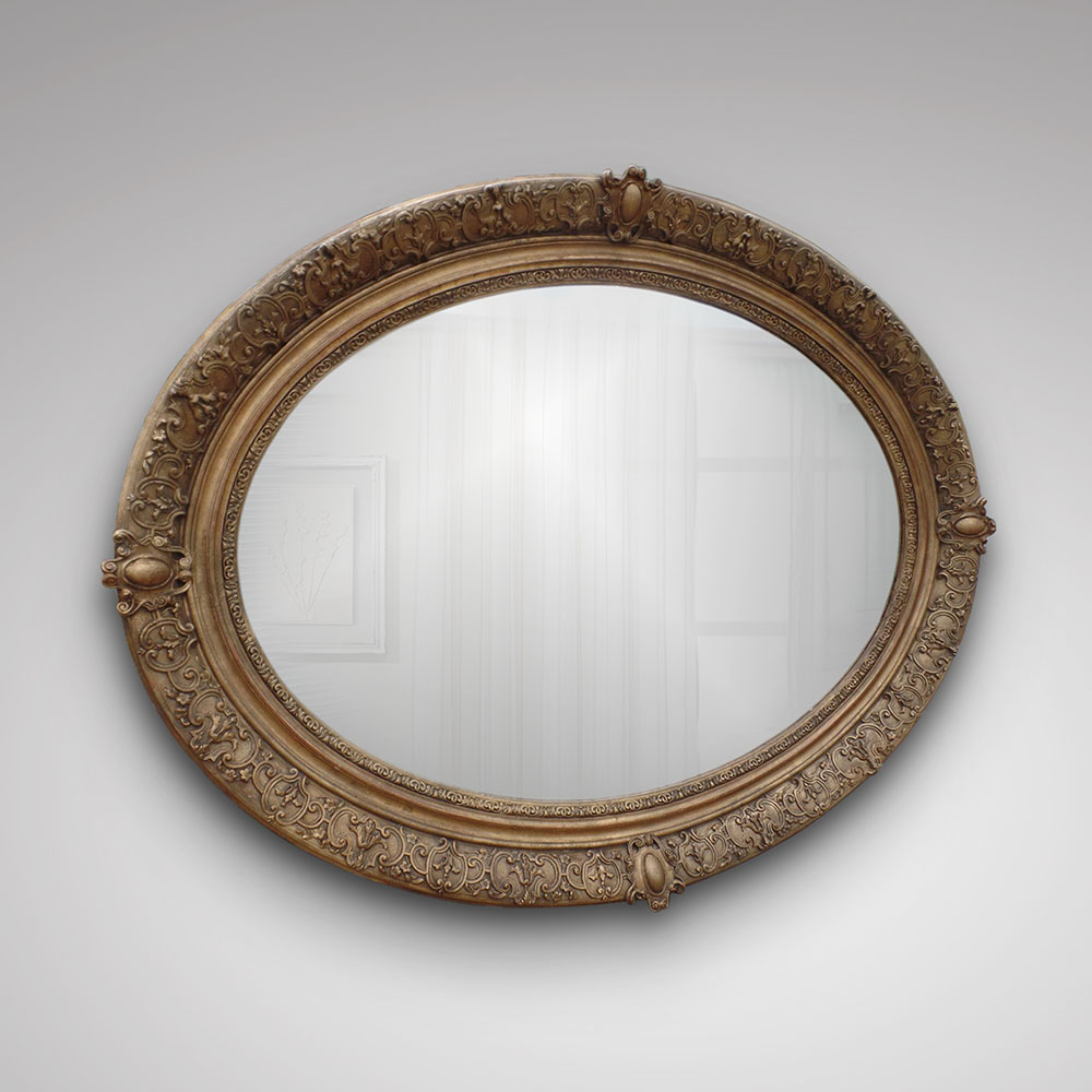 A Large and Attractive Oval Gilt Framed Mirror, ca. 1815-25